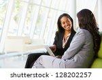 businesswomen with digital... | Shutterstock . vector #128202257