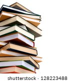 A high pile of books isolated white background - stock photo