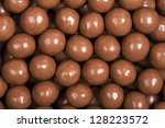 A background of milk chocolate sweets. - stock photo