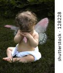 Little Fairy baby with torn wing - stock photo