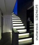 Modern house stairs with lighting - stock photo