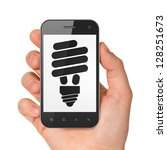 Business concept: hand holding smartphone with Energy Saving Lamp on display. Generic mobile smart phone in hand on White background. - stock photo