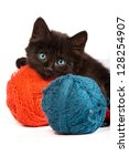 Stock photo black kitten playing with a red ball of yarn isolated on a white background 128254907