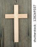 wooden cross on wood background | Shutterstock . vector #128269337