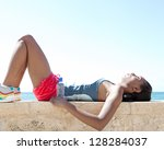 black woman laying down on a... | Shutterstock . vector #128284037