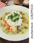 Small photo of a plate with rice and colorful chicken fricassee