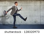 happy businessman walking to... | Shutterstock . vector #128320973
