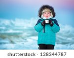 Cute five years old boy drinking hot tea in winter - stock photo