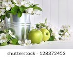 green apples with blossoms on... | Shutterstock . vector #128372453