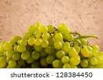 green grapes on a light patterned background - stock photo