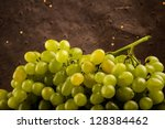 Green fresh grapes on a dark patterned background - stock photo