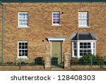 Facade of a new house with green door - stock photo