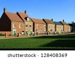 Brand new houses on a village green - stock photo