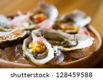 oysters with Asian sauces in ice on the plateau - stock photo