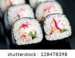 Horizontal shot of Dragon rolls, close-up - stock photo