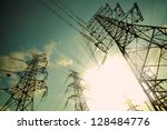 The transmission tower on blue sun sky background - stock photo