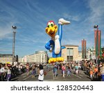BRUSSELS, BELGIUM-SEPTEMBER 8: Giant Duck in annual Balloons Day Parade arrives to Place de l'Albertine on September 8, 2012 in Brussels, Belgium. - stock photo