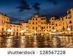 Amphitheater square in Lucca after rain. Tuscany, Italy. - stock photo