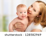 A happy family. young mother with baby - stock photo