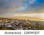dramatic sky over city ponta... | Shutterstock . vector #128590337