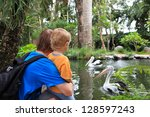 Family Looking At Pelicans