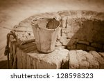 A Water Well With An Old Bucke...