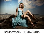 Portrait Of Fashion Woman In Blue Dress Outdoor - stock photo