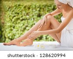 Beautiful Woman Legs And Cream. - stock photo