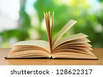 opened book on bright background | Shutterstock . vector #128622317