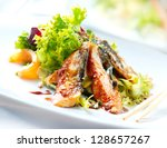 salad with smoked eel with... | Shutterstock . vector #128657267
