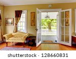 Living room with open doors to the front porch. Romantic classic with park view. - stock photo