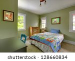 Kids teenager  bedroom with desk and green walls. - stock photo