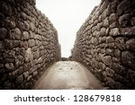 An old stone alley in machu picchu, Peru - stock photo