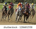 "ARCADIA, CA - FEB 16: Jockey Rafael Bejarano pilots ""Midnight Lucky"" (gray horse) to her first win at Santa Anita Park on Feb 16, 2013 in Arcadia, CA. - stock photo"