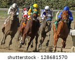 "ARCADIA, CA - FEB 16: Jockeys turn and head down the homestretch in the 3rd race at Santa Anita Park on Feb 16, 2013 in Arcadia, CA. Eventual winner is Kevin Krigger (outside) and ""Cee's the Year"". - stock photo"
