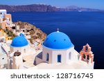 Famous blue dome churches of Santorini, Greece overlooking the scenic caldera - stock photo