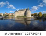 Orebro Castle in autumn sunny day, Sweden - stock photo