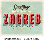 vintage touristic greeting card ... | Shutterstock .eps vector #128754287