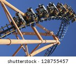 moving roller coaster with blue ... | Shutterstock . vector #128755457