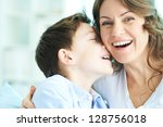 Family of ecstatic mother and son laughing - stock photo