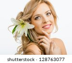 beautiful smiling woman with a...   Shutterstock . vector #128763077