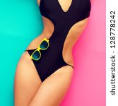fashion girl in a bathing suit on a bright background - stock photo