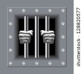 prison bars with his hands | Shutterstock .eps vector #128820577