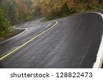 Wet Winding Road In Autumn Wit...