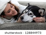 young woman cuddling her dog | Shutterstock . vector #128844973