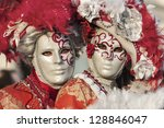 VENICE-FEB 18: Unidentified couple wearing sophisticate Venetian disguises on February 18, 2012 in Venice. In 2012 the Venice Carnival was held between February 11- 21. - stock photo