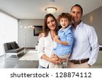 Young happy family at home - stock photo