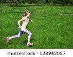 little girl running on green... | Shutterstock . vector #128962037