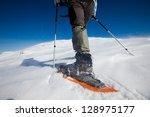 hiker in winter mountains   Shutterstock . vector #128975177