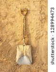shovel on pile of dry soil  at... | Shutterstock . vector #128994473